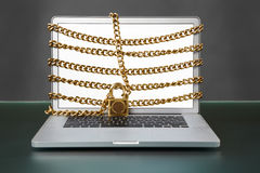 Open laptop with chain and lock Royalty Free Stock Image