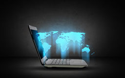 Open laptop computer with world map Stock Photography