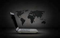 Open laptop computer with world map Stock Photo