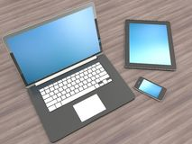 Open laptop with digital tablet and white smartphone Royalty Free Stock Photography