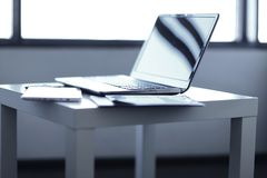 Open laptop digital tablet and work documents on the Desk stock photography