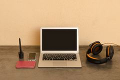 Open laptop, headphones, smartphone and notepad. Workplace Prepa. Ration Royalty Free Stock Photo