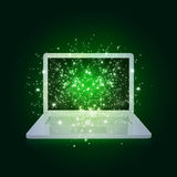 Open laptop with magic light and falling stars Royalty Free Stock Photo