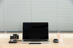 Open laptop with media equipment Stock Photo
