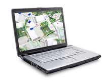 Open laptop with money Stock Images