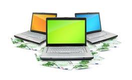 Open laptop with money Stock Photos