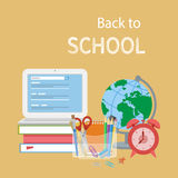 Open laptop with search form, textbooks, alarm clock, globe, stationery, notebook, pencils, scissors. Stock Image