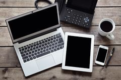 Open laptop with white digital tablet and smartphone on desk fro. M above with  screen Stock Photos
