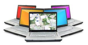 Open laptops with money Stock Photos