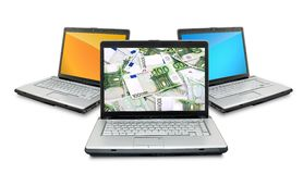 Open laptops with money Stock Images