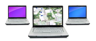 Open laptops with money Stock Image