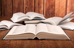 Open large book on a wood table Royalty Free Stock Images