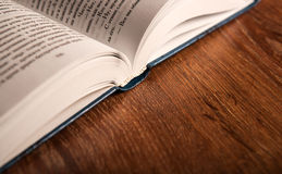 Open large book on a wood table Royalty Free Stock Photography
