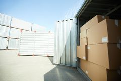 Open large container with stack of boxes Royalty Free Stock Photo