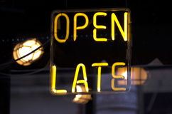 Open Late Neon. A neon sign in the window of a restaurant bar announces they stay open late stock photography