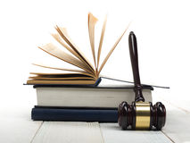Open law book with wooden judges gavel on table in Stock Photo