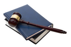 Open law book with wooden judges gavel on table in Stock Photography