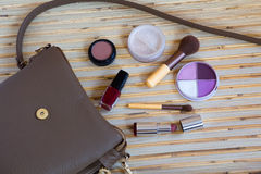 Open leather bag with women cosmetics Stock Photography