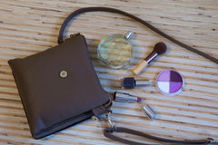 Open leather bag with women cosmetics Stock Images
