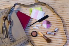 Open leather bag with women cosmetics Royalty Free Stock Photos