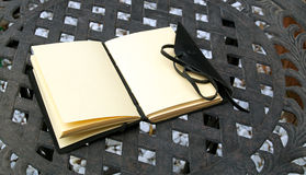 Open leather bound journal outside on table Royalty Free Stock Images