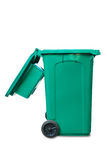 Open lid green garbage bin Stock Image