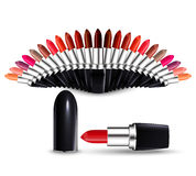 Open lipstick with a cap and a fan of multicolored lipsticks  on white background. Royalty Free Stock Photos