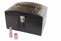 Open lipstick and make up box. Pink lipstick and black make up box on white background Royalty Free Stock Image