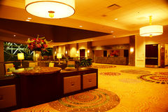 Open Lobby and reception area. Big wide open reception are with yellow lights and fancy carpet Stock Images