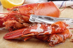 Open lobster pincer on wooden board. Lobster pincer was opened with a nutcracker Stock Photo
