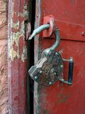 The open lock. The open old, rusty hinged lock. A close up Stock Photos