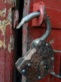 The open lock. The open  old, rusty hinged lock. A close up Royalty Free Stock Photography
