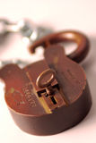 Open lock and key. Old lock and key with chain stock image