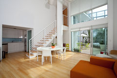 Open loft apartment. An open loft apartment condo with stairs and patio Royalty Free Stock Images