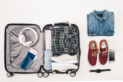 Open luggage with traveler`s accessories, tickets, passports and digital device Stock Photo