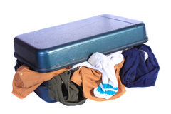 Open Luggage with underwear hanging out. Open luggage with underwear, socks and other cloths hanging out Stock Photo
