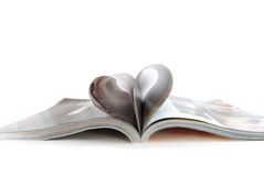 Open magazine. And pages like heart royalty free stock photo