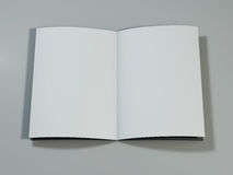 Open magazine with blank pages. 3D rendering. Open magazine with blank pages on white desk. 3D rendering Stock Photo
