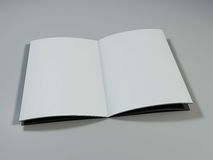 Open magazine with blank pages. 3D rendering. Open magazine with blank pages on white desk. 3D rendering Royalty Free Stock Photo