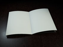 Open magazine with blank pages. 3D rendering. Open magazine with blank pages on wood desk. 3D rendering Stock Photos