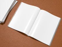 Open magazine cover with blank white page mockup  on leather substrate Royalty Free Stock Image
