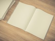 Open magazine cover with blank white page mockup on vintage wooden substrate Stock Photos