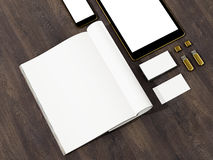 Open magazine, tablet, business cards cover with blank white page mockup on vintage wooden substrate Stock Images