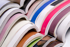 Open Magazines. Stack of open color magazines Stock Photo
