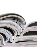 Open magazines on a white background Stock Photos