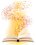 Open Magic Book. A book opens with magical stars and illumination Royalty Free Stock Image
