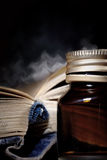 Open magic book and vial Royalty Free Stock Photos