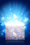 Open magic gift box with bright light Stock Photo