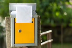 Open mailbox with letters shot with low depth of field. Open mailbox with received letters shot with low depth of field Stock Images
