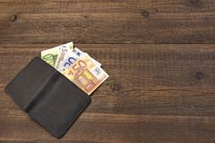 Open Male Black Leather Wallet With Euro Bills On Wood Royalty Free Stock Photography